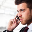 Businessman using a cell phone — Stock Photo #6960712