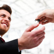 Businessman receiving a key — Photo