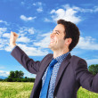 Royalty-Free Stock Photo: Young businessman victory