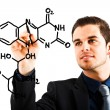 Scientist drawing a chemical formula — Stock Photo