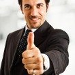 图库照片: Businessman showing thumb up