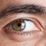 Macro shot of man's green eye — Stock Photo