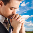 Young man praying — Stockfoto