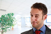 Winking businessman portrait — Stockfoto