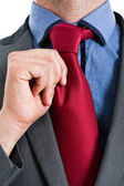 Businessman adjusting his tie — Foto Stock