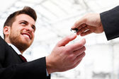 Businessman receiving a key — Stock Photo