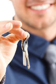 Businessman giving keys — Stock Photo