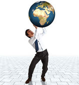 Businessman supporting the world — Stock Photo