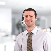 Young man wearing headset — Stock Photo