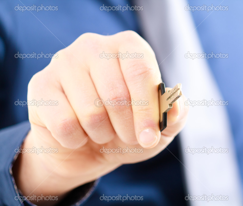 Businessman using a key to open something. — Stock Photo #6961763
