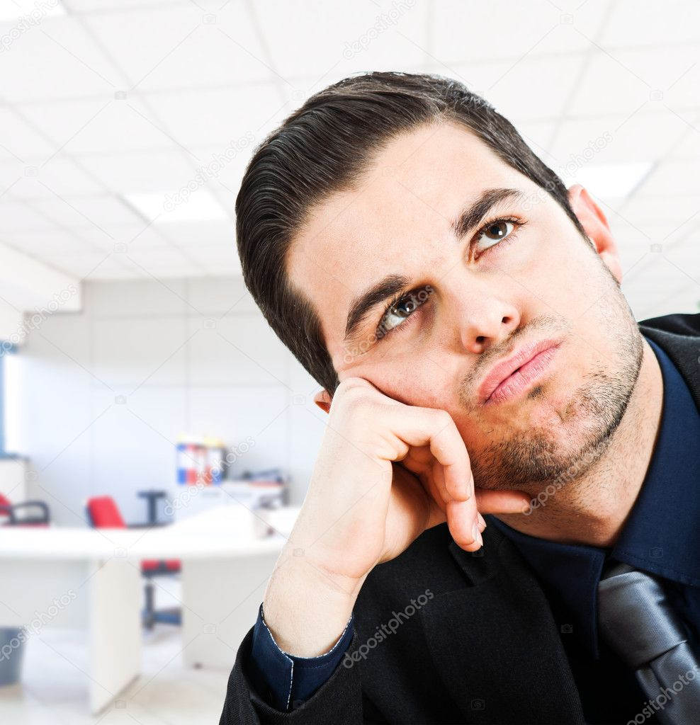 Bored businessman panting in his office — Stock Photo #6961764