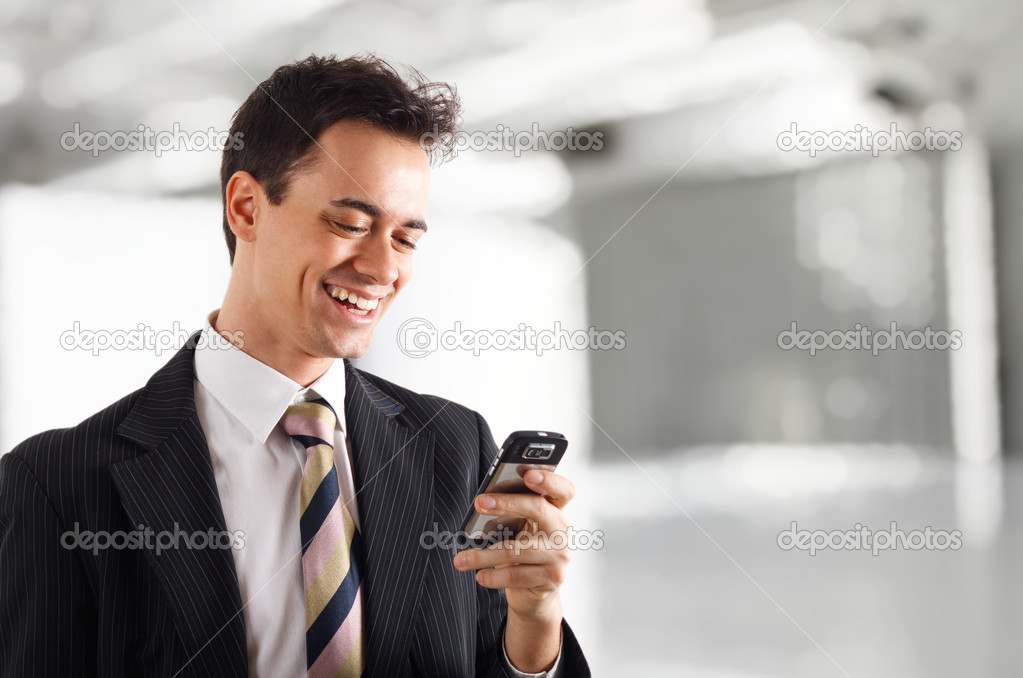 Man reading a pleasing text message  Stock Photo #6969399