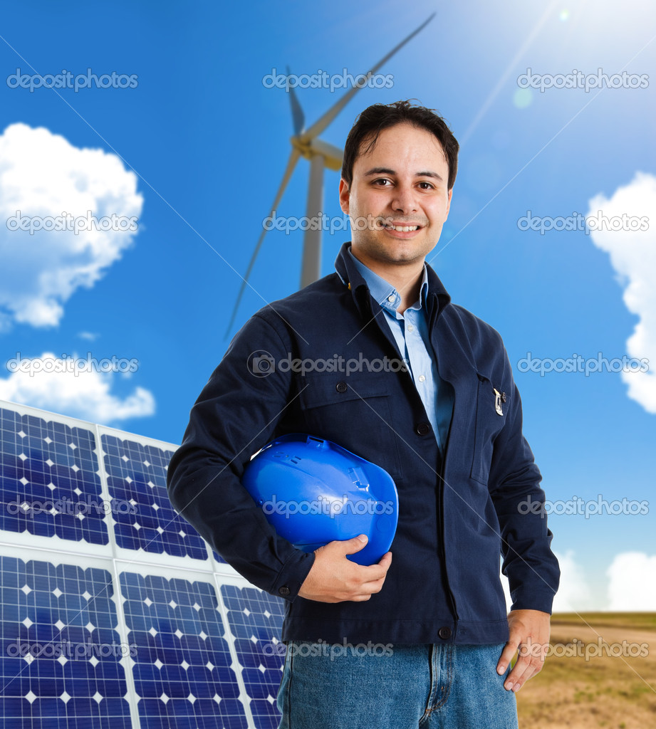 Portrait of a smiling worker in front of a wind power plant and a solar panel — Stock Photo #6969863
