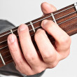 Performer playing electric guitar — Stock Photo
