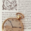 Old clock and antique book - Stock Photo