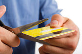 Scissors cutting a credit card — Stock Photo