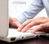 Worker using a laptop — Stock Photo
