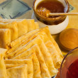 Stock Photo: Pancackes and honey