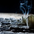 Blue smoke with candls on wooden shelf - Stockfoto