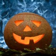 Glowing halloween pumpkin and blue smoke — Stock Photo