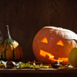 Pumpkins with candle and leafs — Stock Photo #6881600