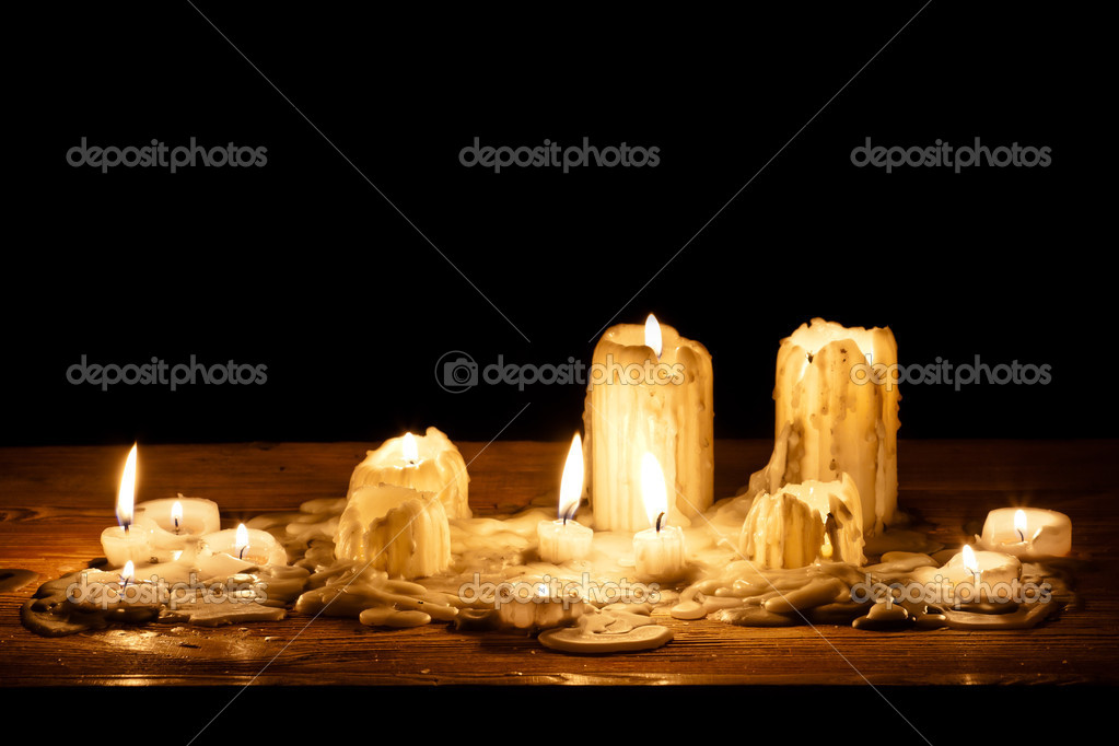 Melting candle in wooden shelf — Stock Photo #6881441