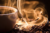 Strange golden smoke taking away from coffee seeds — Stock Photo