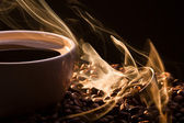 Golden fragrance fly away from roasted coffee — Stock Photo