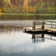 Old wooden jetty over the lake at autumn — Stock Photo