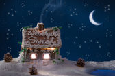 Smoke poured out of the gingerbread home at night — Photo