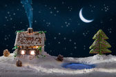 Gingerbread home with blue smoke and moon with stars — Stock Photo