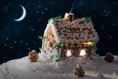 Snowy gingerbread home and moon at night in winter — Stock Photo