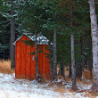 Stock Photo: Alaskan outhouse in the snow