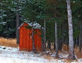 Alaskan outhouse in the snow — Stok fotoğraf