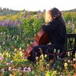 Outdoor cello practice in spring - Stock Photo