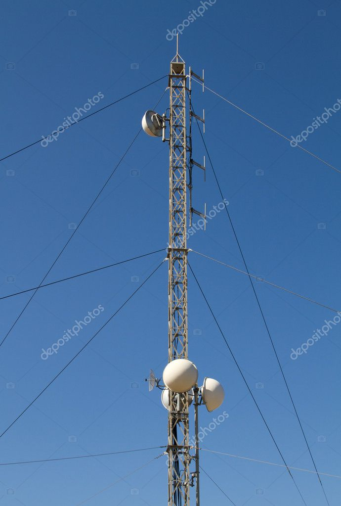 Antenna pylow with repeaters on blue sky  Stock Photo #6803073
