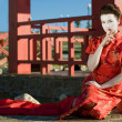 Geisha Sitting Near The Japanese Arbor — Stock Photo