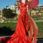 Geisha with umbrella — Stock Photo