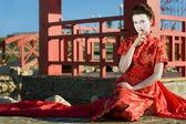 Geisha Sitting Near The Japanese Arbor — Stock Photo
