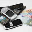 Stock Photo: Change used mobile phones for money