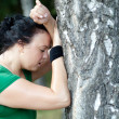 Sweaty overweight woman catching her breath after a long run - Stock Photo