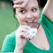 Overweight woman eating a chocolate right after training — Stock Photo