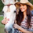 Happy cowgirl with her white horse — Stock Photo