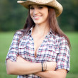 Beautiful smiling cowgirl - Stock Photo