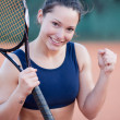Cheerful tennis player — Stock Photo