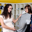 Friends buying clothes — Stock Photo