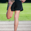 Girl stretching on a running track — Stock Photo #7325392