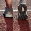 Stock Photo: Walking on a running track. Close up of running sneakers