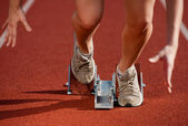 Action packed close-up image of a female athlete — Stock Photo