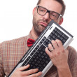 Nerd in love with his keyboard — Stock fotografie